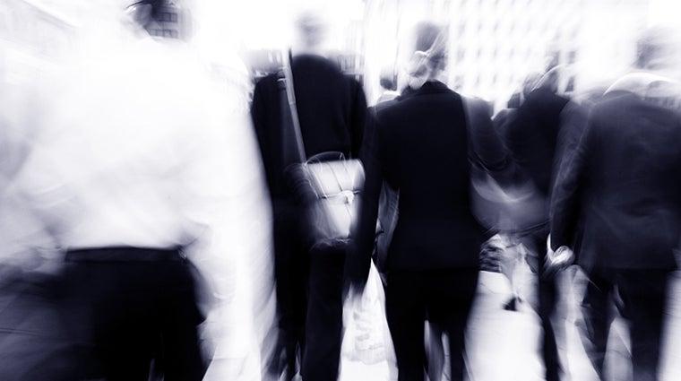 people walking to work, rushing on busy street