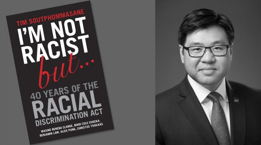 "Dr Tim Soutphommasane with the cover of his book ""I'm not racist but..."""