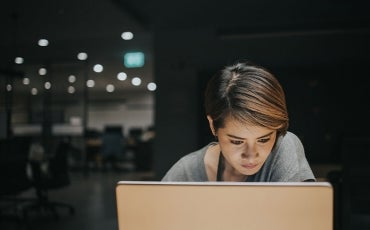 woman working late on laptop