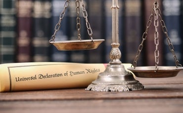 Scales of Justice with parchment scroll of UDHR