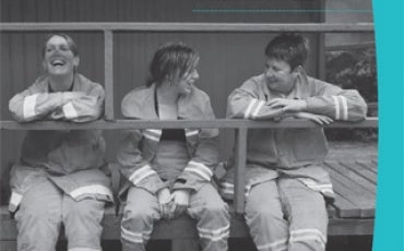 Cover of Annual Report 2012-13. Volunteer firefighters sit on a verandah chatting