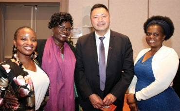 Commissioner Chin Tan and African women