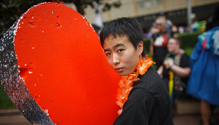 Sydney 2017 Gay Lesbian Mardi Gras marcher with huge heart prop. Photo Matthew Syres