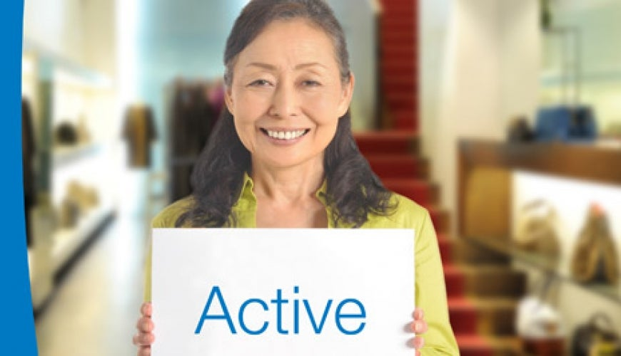 "older woman with a sign ""Active"""