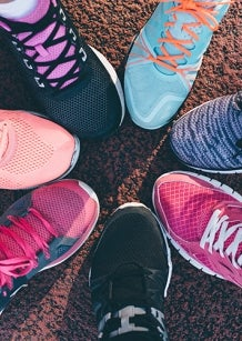colourful range of runnning shoes in a circle