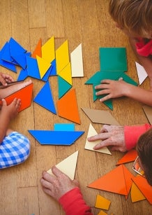 children playing with geometric shapes